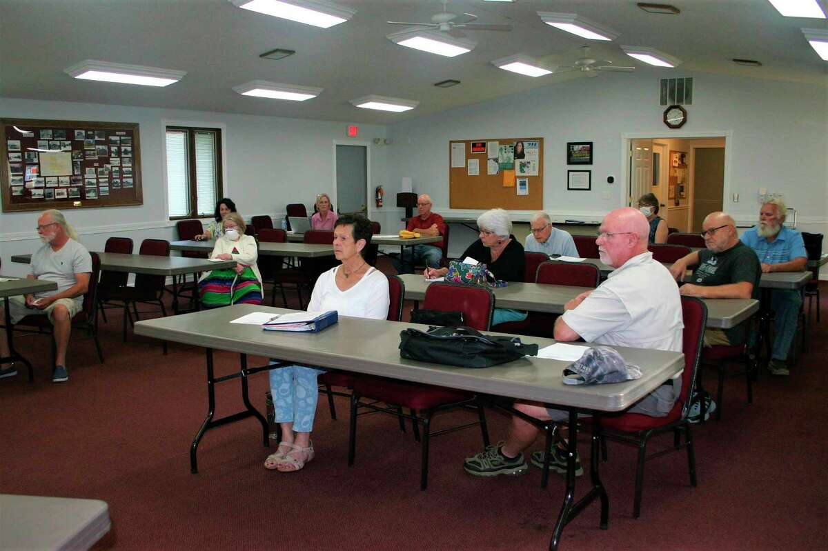 Several residents of the Tri Lakes area in Mecosta showed up for a public hearing regarding the finalization of the tax roll for a special assessment district established to control the gypsy moth population. A majority of residents within the special assessment district are in favor of the assessment. (Pioneer photo/Cathie Crew)