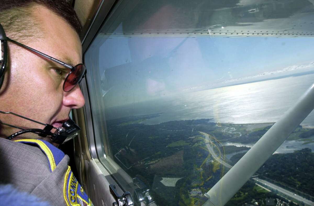 In the skies above Westport, state trooper Gene Baron spots speeding motorists from 2,000 feet while on patrol above Interstate 95 in a single-engine Cessna.