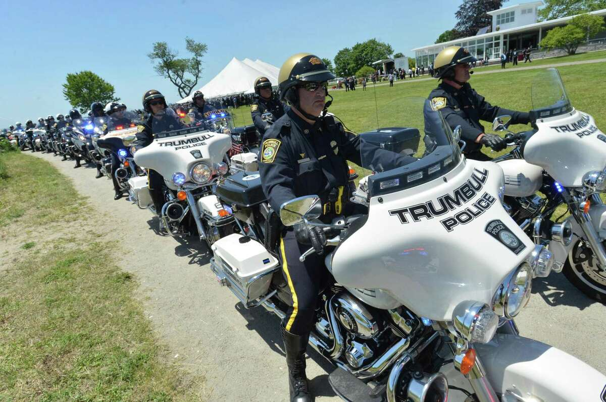 Funeral service for Connecticut State Trooper First Class Walter Greene Jr. on Tuesday June 12, 2018 at Sherwood Island State Park in Westport Conn.
