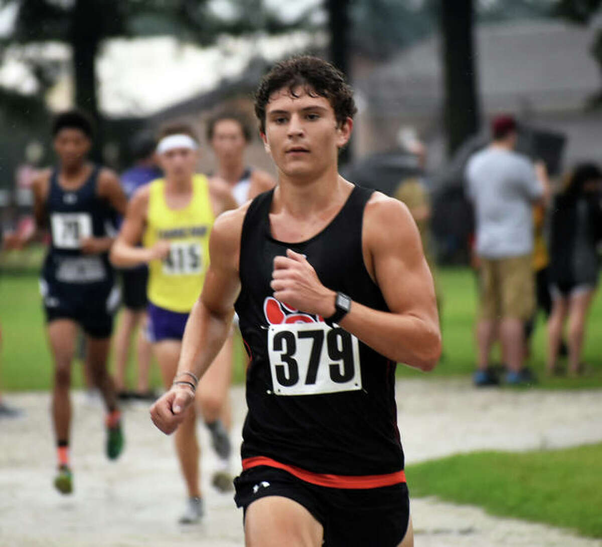 Edwardsville's Ryan Luitjohan runs down a rock path during the first mile of the Granite City Invitational.
