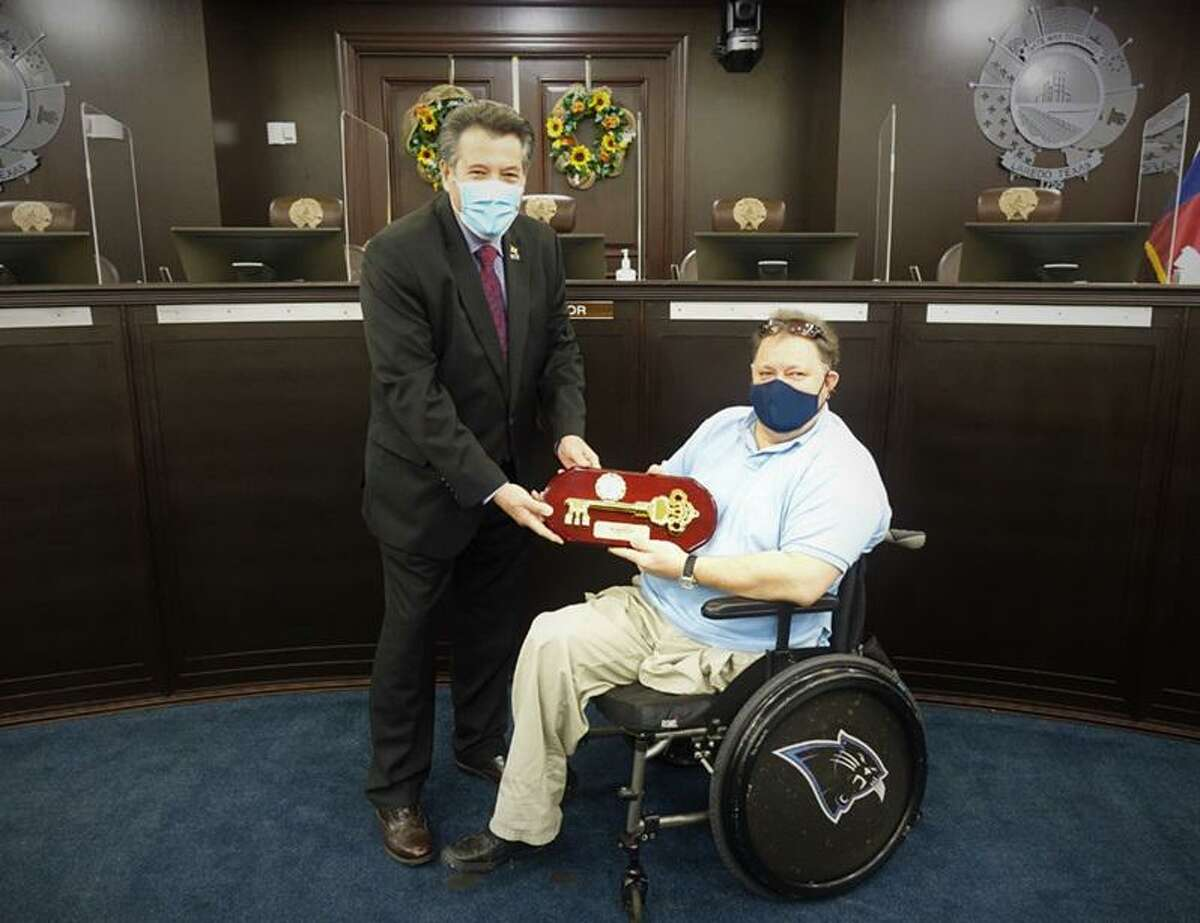 Laredo Mayor Pete Saenz is pictured with Jack Strunk awarding him a replacement key to the city.