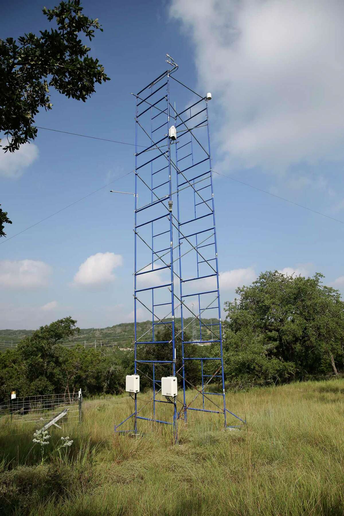 On top of a hill, a tower with instruments measures moister and carbon dioxide in the air at the Edwards Aquifer Conservancy Field Research Park on Wednesday, Sept. 1, 2021.