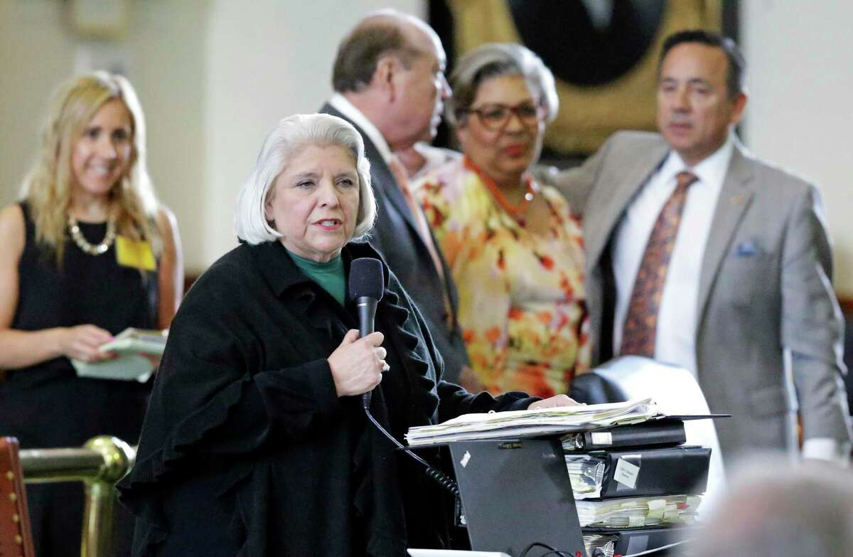 In this 2017 file photo, Senator Judith Zaffirini, D-Laredo, is backed by several other senators as she wins passage in the Senate of her bill to ban texting while driving.