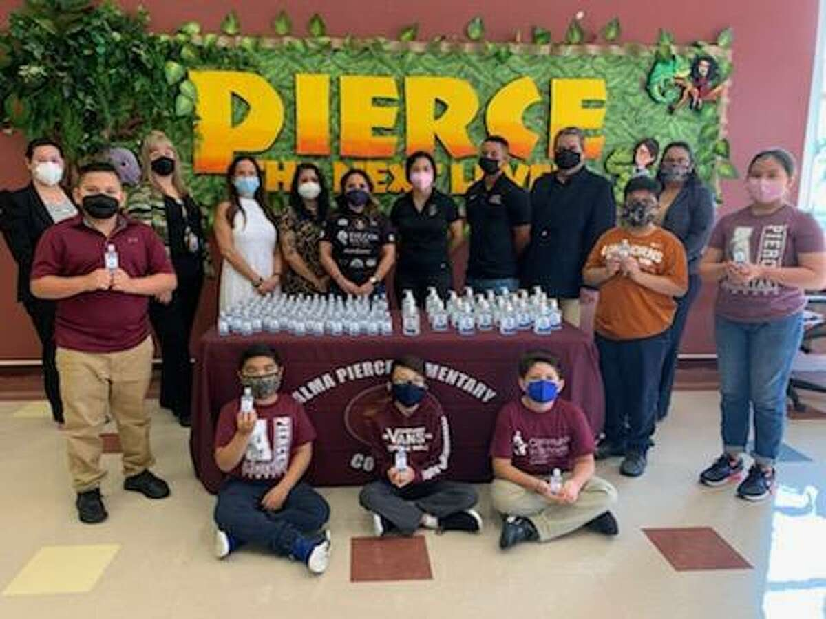 The Vaswani Group, assisted by Volunteer Laredo, donated 7,440 pounds of hand sanitizer to LISD and UISD. Members of both organizations are pictured with Alma Pierce Elementary School students and LISD officials on Friday.