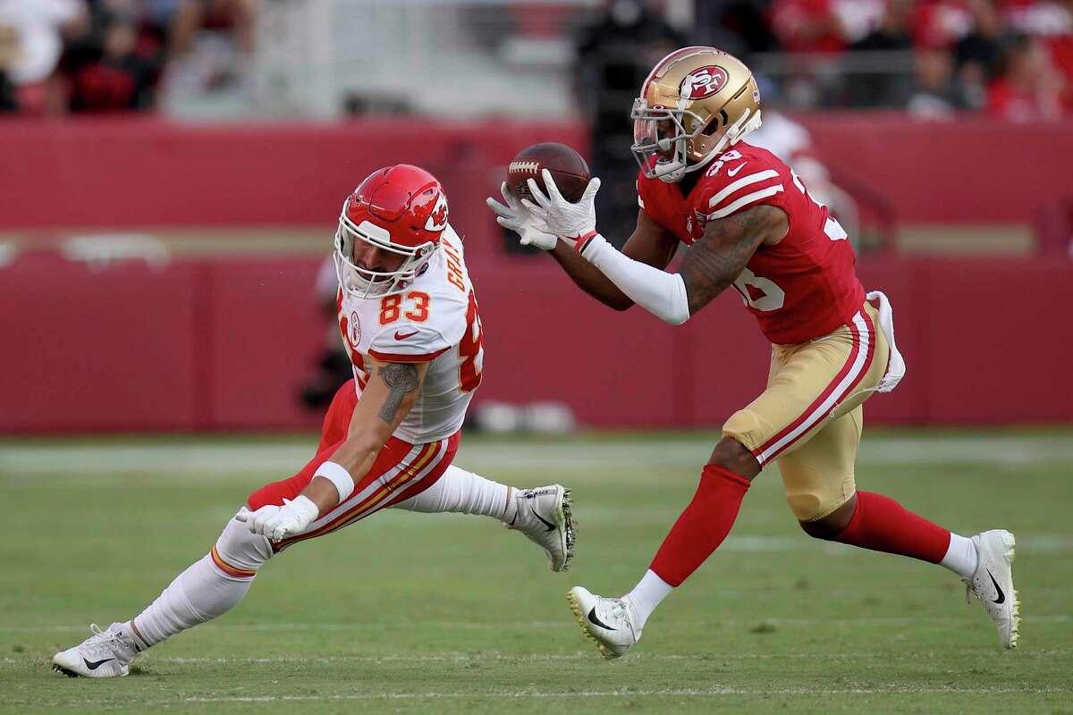 San Francisco 49ers Deommodore Lenoir (38) intercepts a pass intended for Kansas City Chiefs Noah Gray (83) during an NFL football game, Saturday, Aug. 14, 2021, in Santa Clara, Calif. (AP Photo/Scot Tucker)