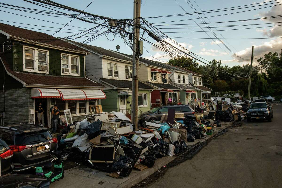 Items destroyed by floodwaters piled up outside homes in Queens on Friday Sept. 3, 2021. Two days after the remnants of Hurricane Ida brought a sudden and ferocious storm to the Mid-Atlantic region, residents on Friday confronted the fallout from a downpour that killed at least 45 people across four states and illustrated with frightening clarity the threat posed by a changing climate.