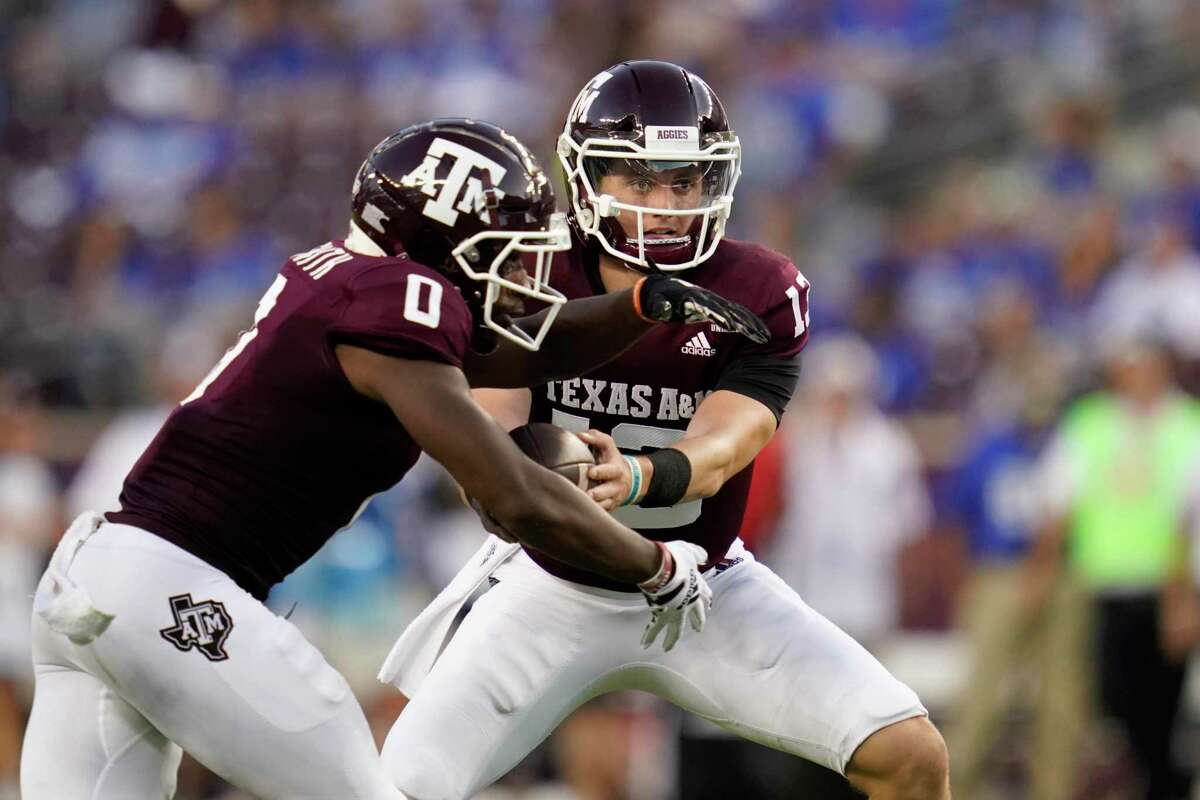 Texas A&M quarterback Haynes King (13) hands the ball off to Texas A&M wide receiver Ainias Smith (0) during the first quarter of an NCAA college football game on Saturday, Sept. 4, 2021, in College Station, Texas. (AP Photo/Sam Craft)