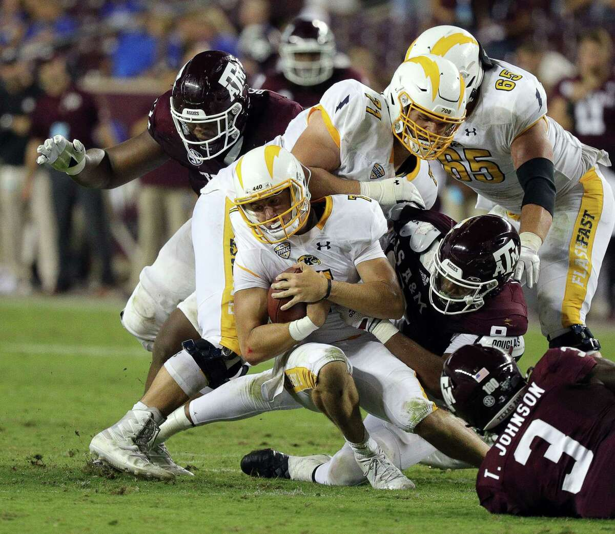 COLLEGE STATION, TEXAS - SEPTEMBER 04: Dustin Crum #7 of the Kent State Golden Flashes is sacked by DeMarvin Leal #8 of the Texas A&M Aggies in the fourth quarter at Kyle Field on September 04, 2021 in College Station, Texas. (Photo by Bob Levey/Getty Images)