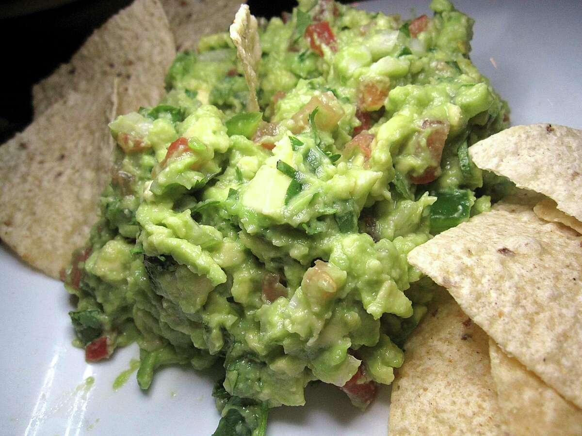 Additions to guacamole including garlic, cumin, cilantro and more came to the Americas with Spanish colonizers.