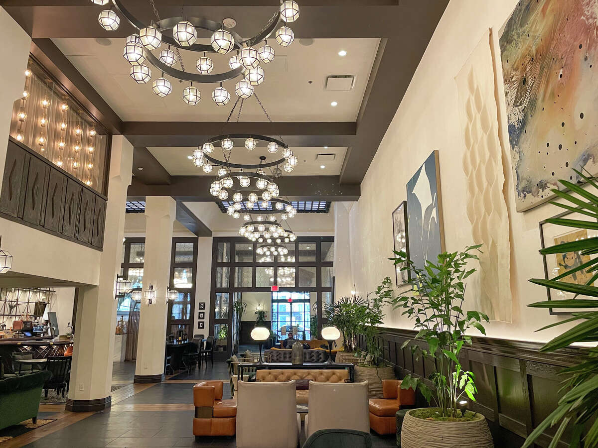 The Hotel Figueroa's grand lobby is packed with plants and large-scale artwork.