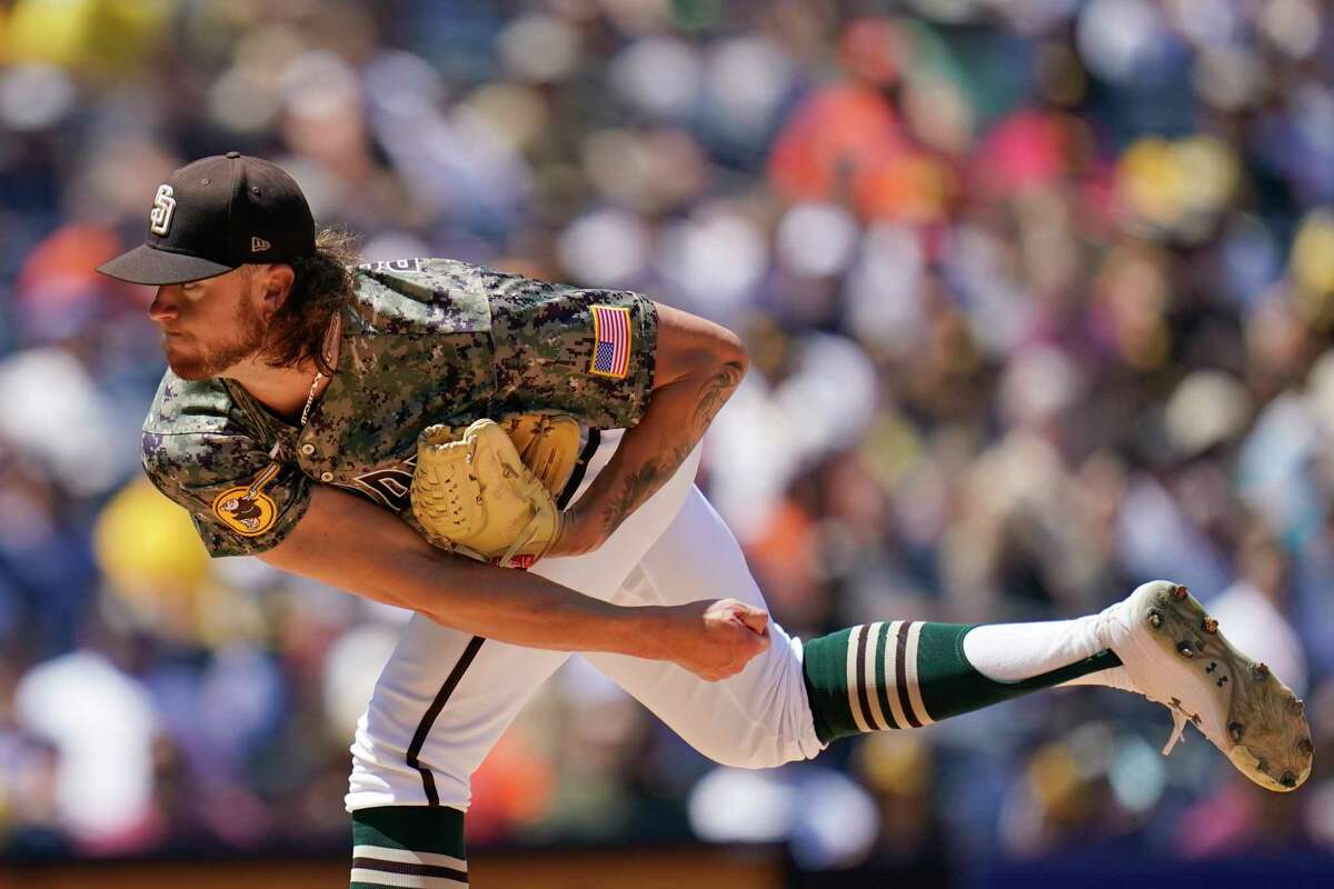 San Diego Padres starting pitcher Chris Paddack works against a Houston Astros batter during the first inning of a baseball game Sunday, Sept. 5, 2021, in San Diego. (AP Photo/Gregory Bull)