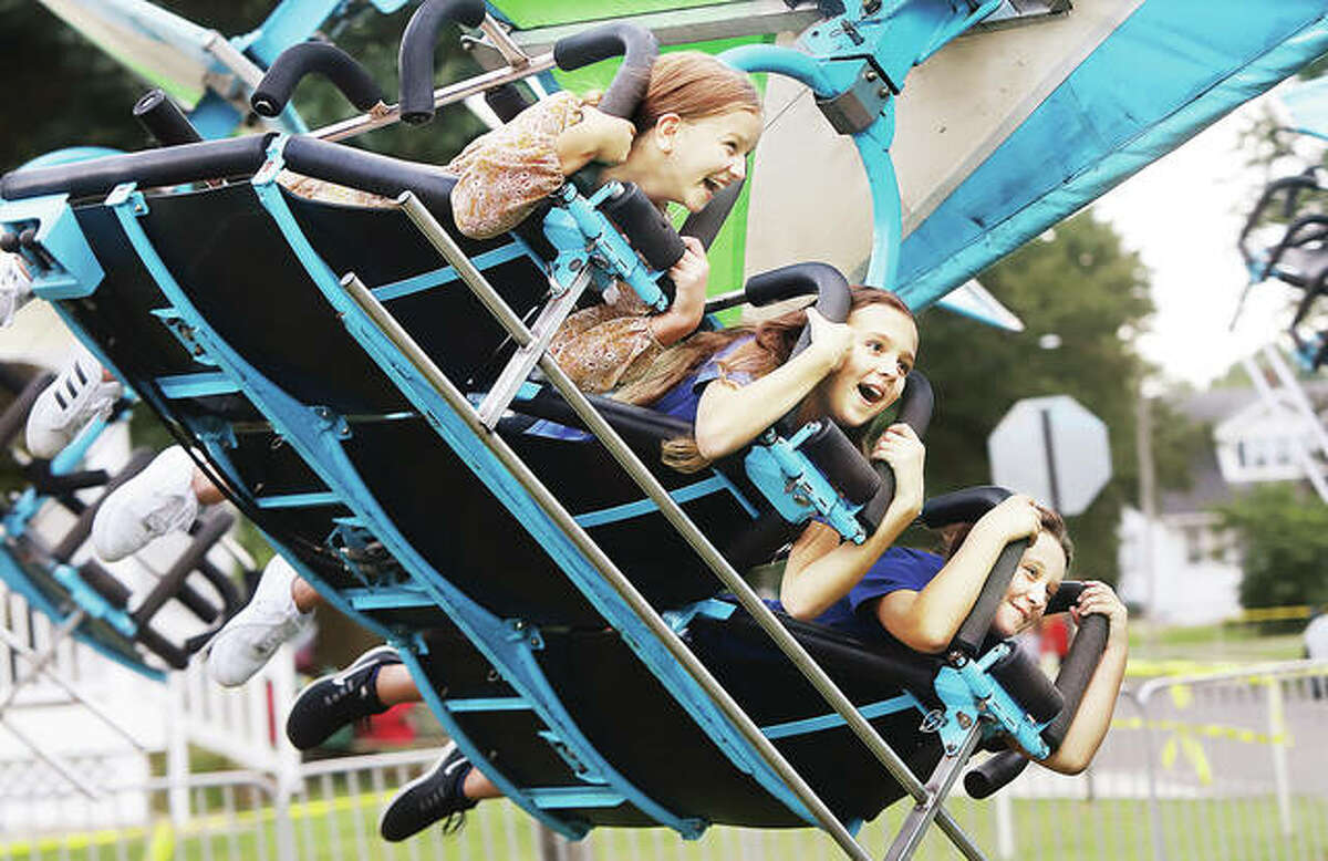 Arabelle Marburger, 9, left, her sister, Ahnalle Marburger, 11, center, both from Godfrey, and their friend, Averi Lowe, 10, from Bethalto, seemed to be enjoying their time on the Hang Glider ride at the Bethalto Homecoming over the weekend. Hundreds packed the midway Friday for opening night of the homecoming. The event runs through Monday. More photos appear online at thetelegraph.com.
