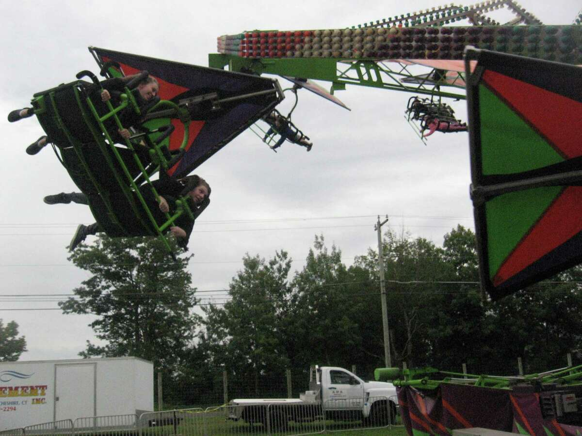 Goshen Fair visitors ride sideways at the midway Sunday, Sept. 5, 2021 at the Goshen Fairgrounds.