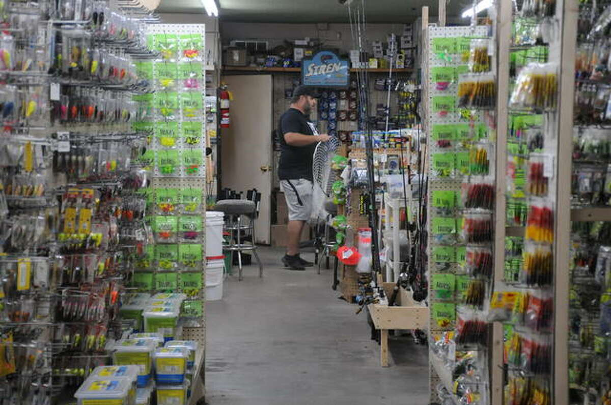 An angler browses through Bluff City Outdoors in Alton. After a pandemic pause last year, the store is again hosting the Alton Catfish Classic on Saturday, Sept. 12.