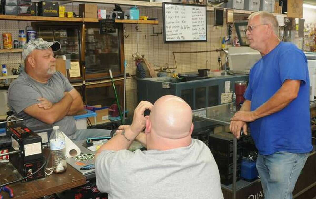 Damon Mason of Bluff City Outdoors, left, discusses the upcoming Alton Catfish Classic with bait supplier Dave Cassens of Grafton. The two expect anglers this year's field of 200 teams will use skipjack, goldfish, Asian carp or shad in the Sept. 11 competition.