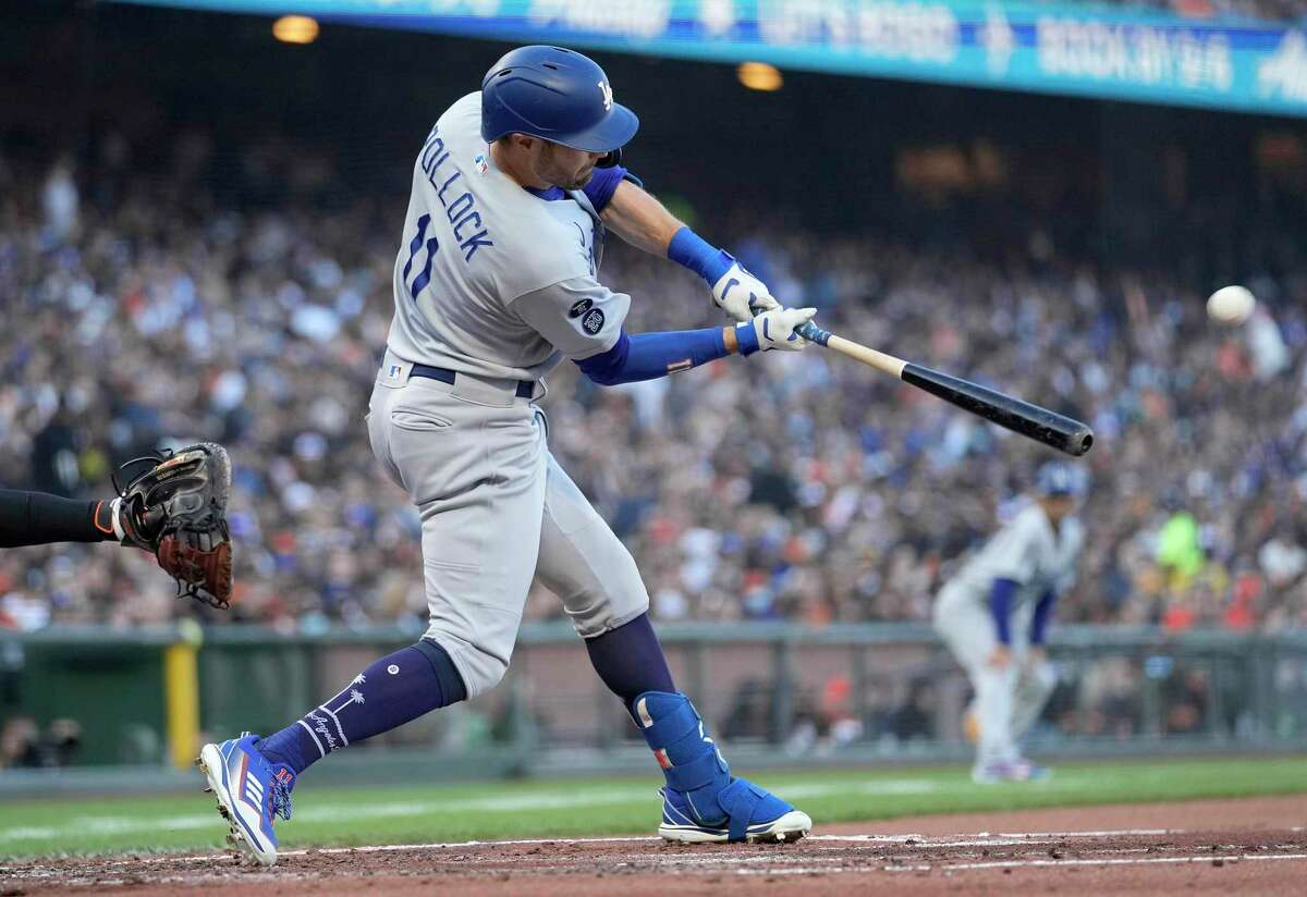SAN FRANCISCO, CALIFORNIA - SEPTEMBER 04: AJ Pollock #11 of the Los Angeles Dodgers hits an RBI double scoring Justin Turner #10 against the San Francisco Giants in the top of the first inning at Oracle Park on September 04, 2021 in San Francisco, California. (Photo by Thearon W. Henderson/Getty Images)