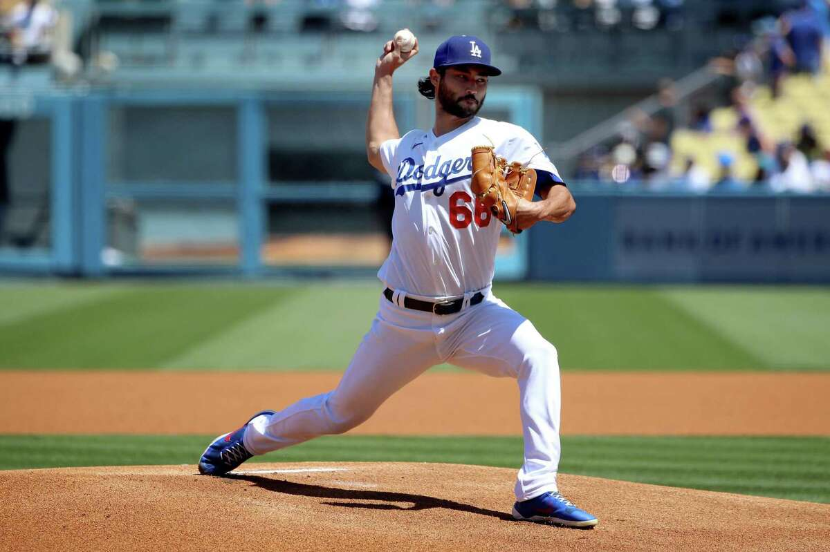 LOS ANGELES, CALIFORNIA - AUGUST 29: Mitch White #66 of the Los Angeles Dodgers pitches during the first inning against the Colorado Rockies at Dodger Stadium on August 29, 2021 in Los Angeles, California. (Photo by Katelyn Mulcahy/Getty Images)
