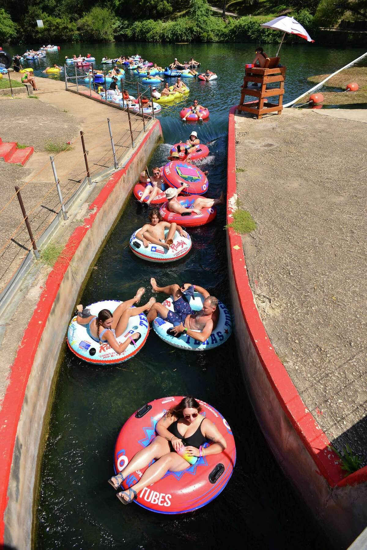 Tubers jam the tube chute as crowds converged on the Comal River in New Braunfels on Sunday during the summer season's last big weekend.