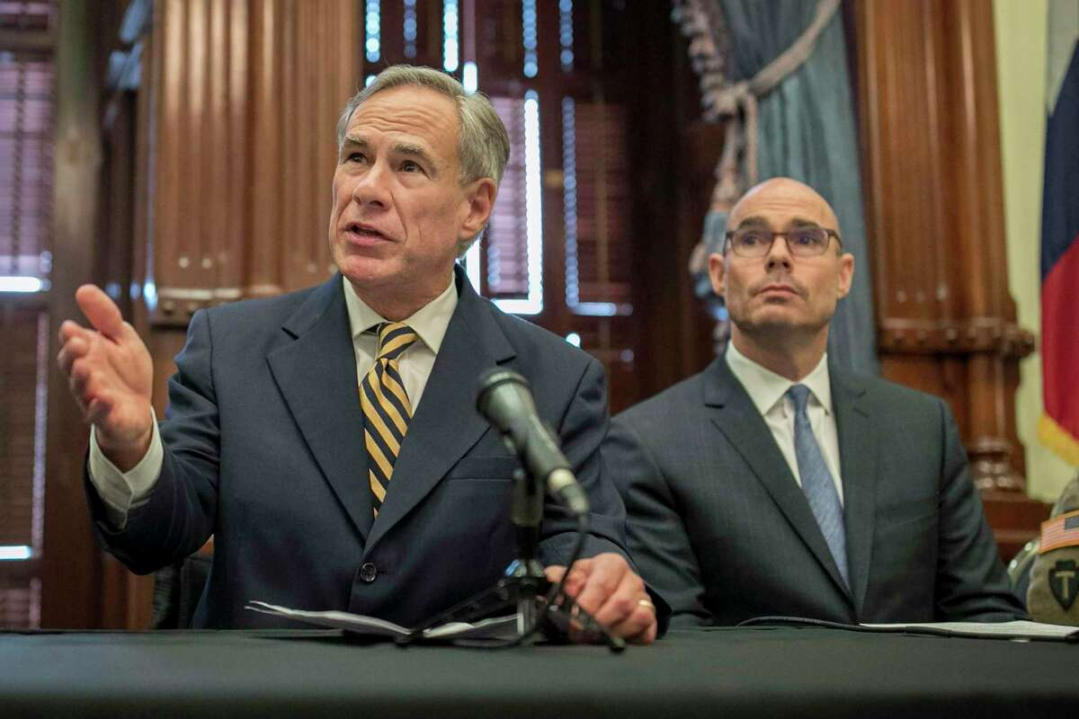 In this June 21, 2019 photo, Gov. Greg Abbott, left, speaks at a news conference at the Capitol, in Austin, Texas.