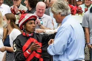 Echo ZuluÕs jockey speaks with trainer Steve Asmussen after winning the 130th running of the Spinaway at the Saratoga Race Course Sunday Sep, 5, 2021 in Saratoga Springs, N.Y. Special to the Times Union Photo  by Skip Dickstein