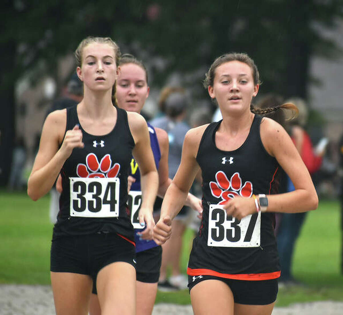 Edwardsville's Maya Lueking, left, and Emily Nuttall run together down a rack path inside Maxwell Park during the Granite City Invitational on Saturday in Granite City.