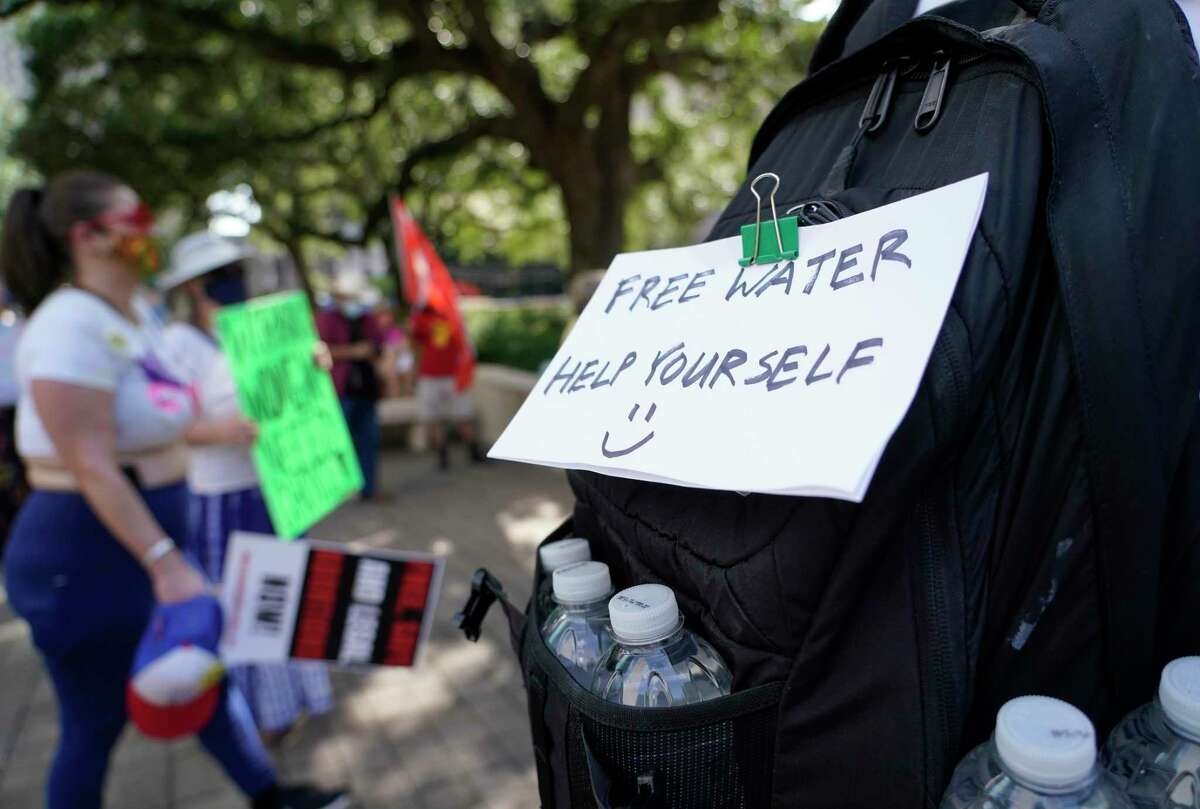 A man offers water during a protest march held by activists from Houston United Front Against Fascism, Houston Socialist Movement and Socialist Alternative-Houston to defend women's reproductive rights Sunday, Sept. 5, 2021 in Houston. The group gathered at Hermann Square at City Hall and marched to the Bob Casey Federal Courthouse on Rusk St.