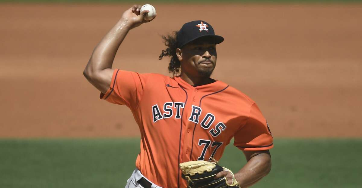 Luis Garcia #77 of the Houston Astros pitches during the second inning of a baseball game against San Diego Padres at Petco Park on September 5, 2021 in San Diego, California. (Photo by Denis Poroy/Getty Images)