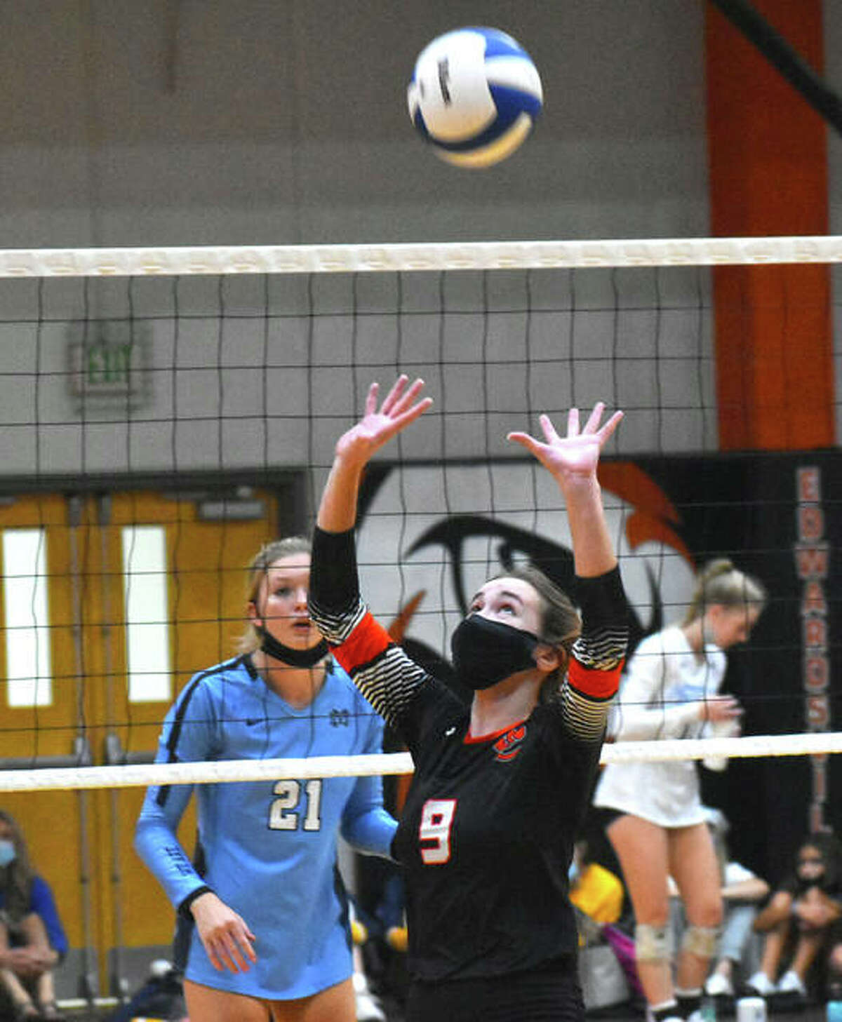 Edwardsville's Madison Vieth sets a pass against Mater Dei in the semifinals of the Tiger Classic on Saturday.