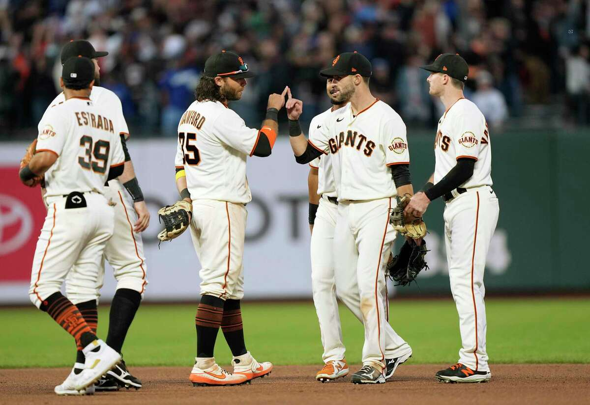 SAN FRANCISCO, CALIFORNIA - SEPTEMBER 05: Brandon Crawford #35 and Steven Duggar #6 of the San Francisco Giants celebrates with teammates after defeating the Los Angeles Dodgers 6-4 at Oracle Park on September 05, 2021 in San Francisco, California.