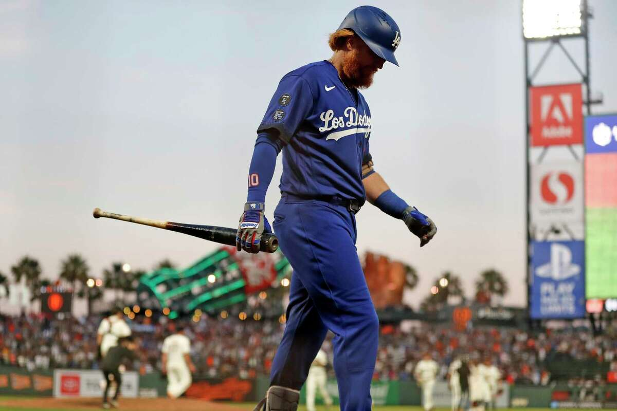Los Angeles Dodgers' Justin Turner heads to the dugout after making final out of San Francisco Giants' 6-4 win in MLB game at Oracle Park in San Francisco.