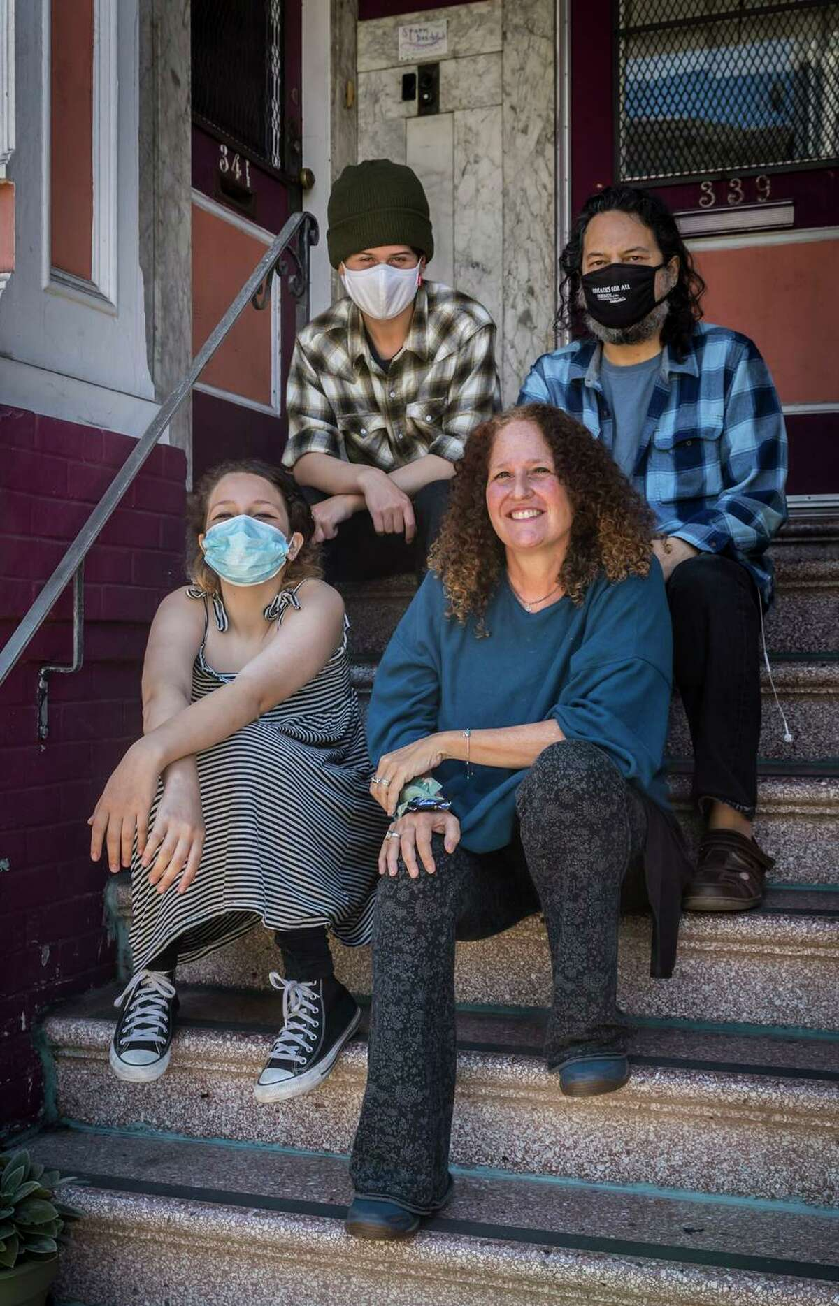 """Marjorie Sturm and husband Ernesto Diaz-Infante (right) with their children, Shoshana (left) and Ezra Sturm. """"I don't understand why our schools aren't doing weekly testing like Los Angeles and other school districts are doing,"""" Marjorie Sturm says."""