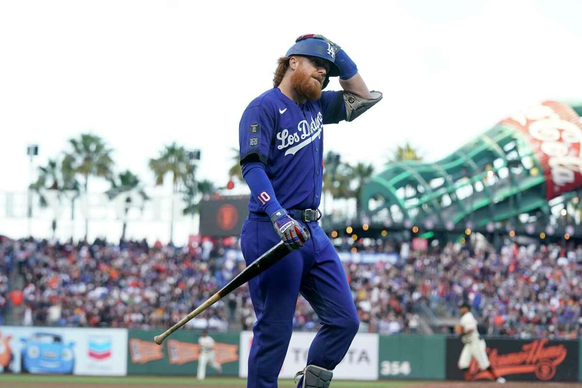 Los Angeles Dodgers' Justin Turner walks to the dugout after striking out against the San Francisco Giants during the seventh inning of a baseball game in San Francisco, Sunday, Sept. 5, 2021. (AP Photo/Jeff Chiu)