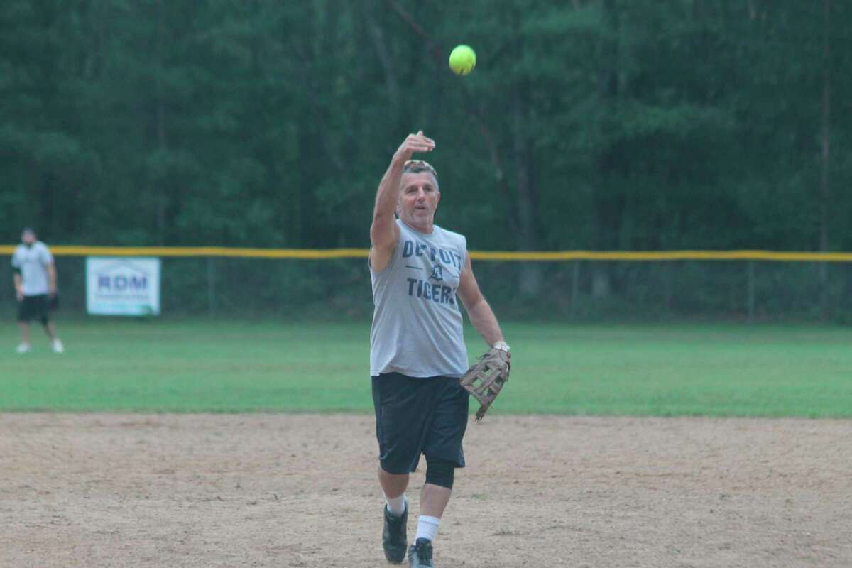 A competitor lobs a pitch during the slow-pitch softball tournament held in Dickson Township Park on Saturday as part of this year's Brethren Days festivities. (Kyle Kotecki/News Advocate)