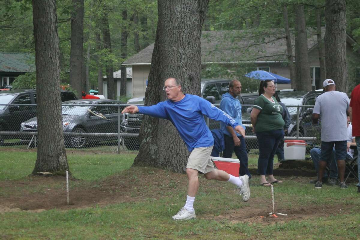 A competitor in the Brethren Days horseshoe tournament makes a toss in Dickson Township Park on Saturday.