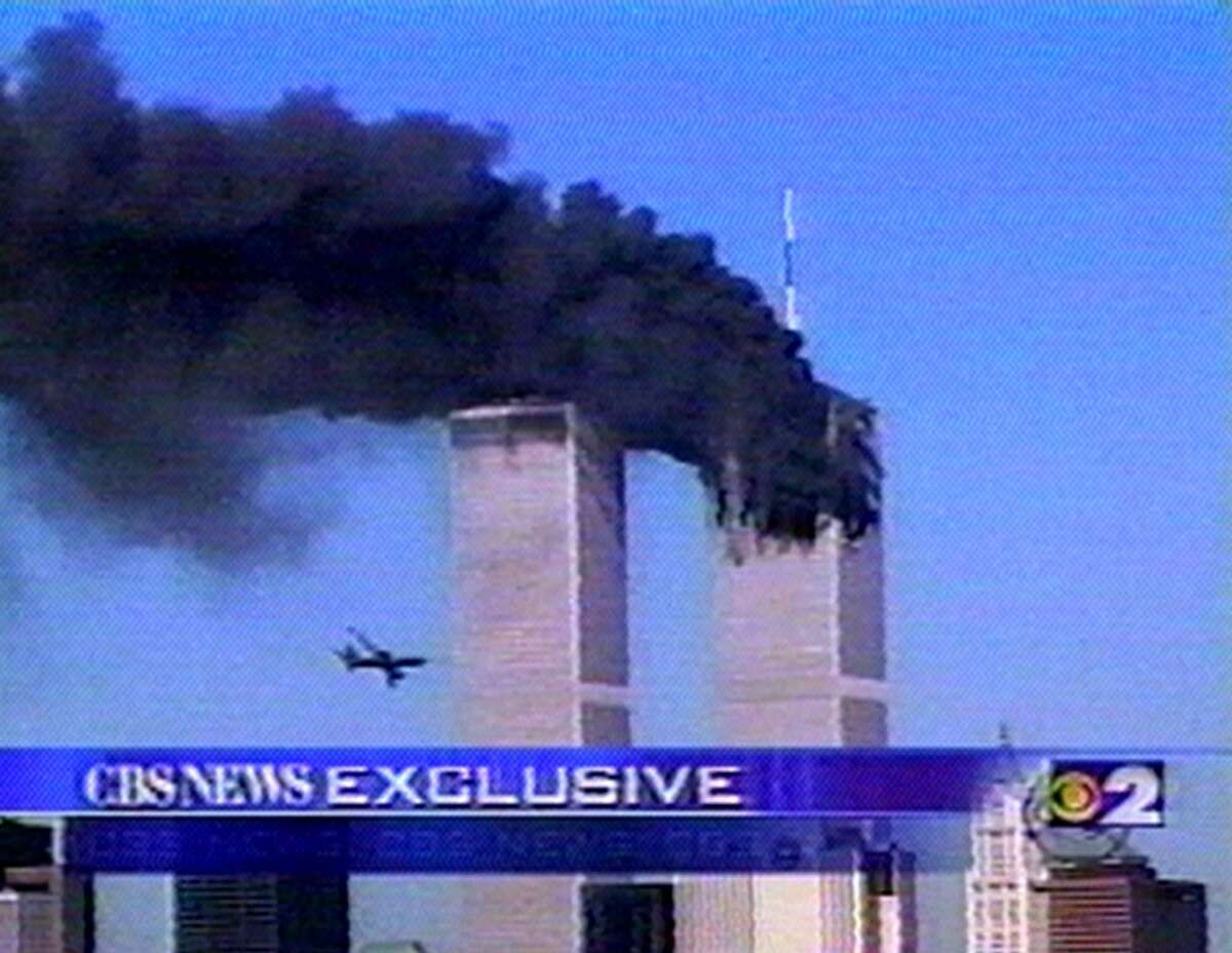In this image fom television, a plane is seen flying toward the World Trade Center in New York, before crashing during a terrorist attack Tuesday, Sept. 11, 2001.