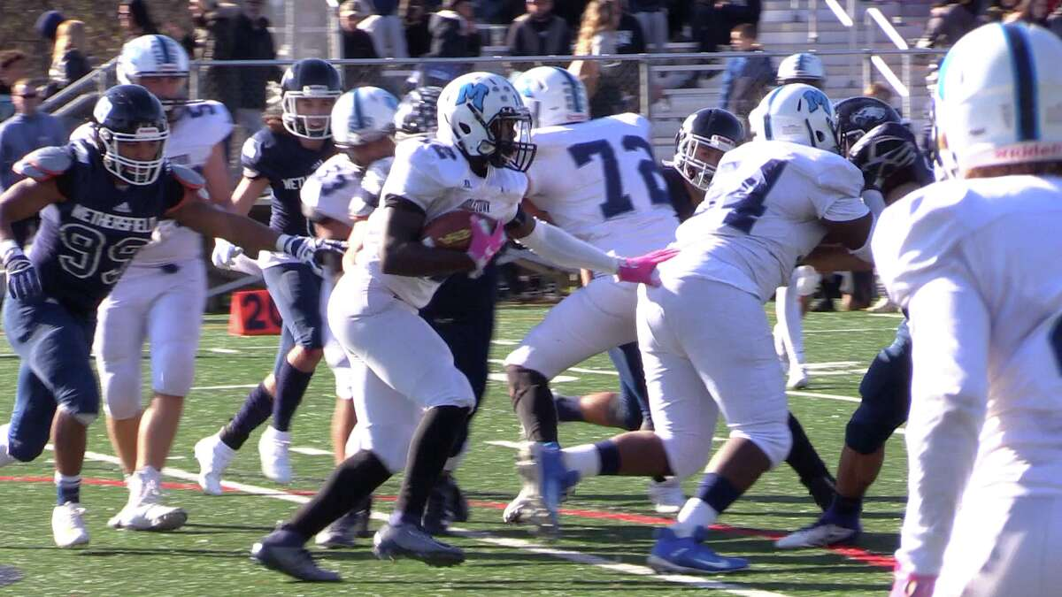 Sophomore Shaun Gaskinsfollows lead blocker and sophomoreT.J. Jackson during a game in 2019. The two are among several veteranMiddletownplayers who are back for 2021.