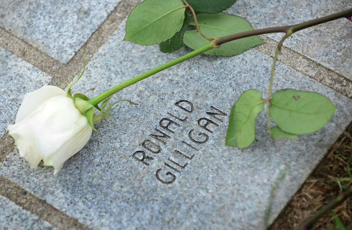 A rose is laid at the memorial for victims including Norwalk resident Ronald Gilligan during the State of Connecticut's 18th annual 9/11 Memorial Ceremony honoring and celebrating the lives of those killed in the September 11, 2001 terrorist attacks Thursday, September 5, 2019, at Sherwood Island State Park in Westport, Conn. Family members of those who were killed in the attacks participated, and the names of the 161 victims with ties to Connecticut were read aloud.