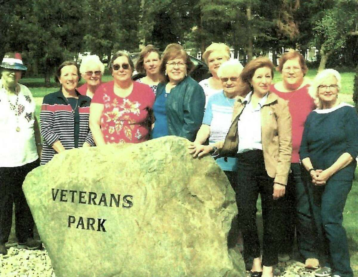 Members of the General Federation of Women's Club of Pigeon Area by the new boulder at Pigeon's Veterans Park earlier this summer. The group has more plans for the park and generally partakes in many local events and fundraisers. (General Federation Women's Club of Pigeon Area/Courtesy Photo)