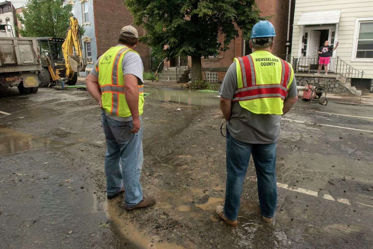 Crews work on fixing a water main break on First Street between Van Buren and Main streets on Monday, Sept. 6, 2021 in Troy, N.Y. The break causes boil water advisories in neighboring communities, which were lifted Sept. 9, 2021.