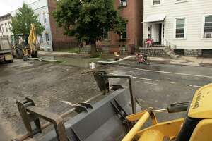 Crews work on fixing a water main break on 1st Street between Van Buren and Main streets on Monday, Sept. 6, 2021 in Troy, N.Y.