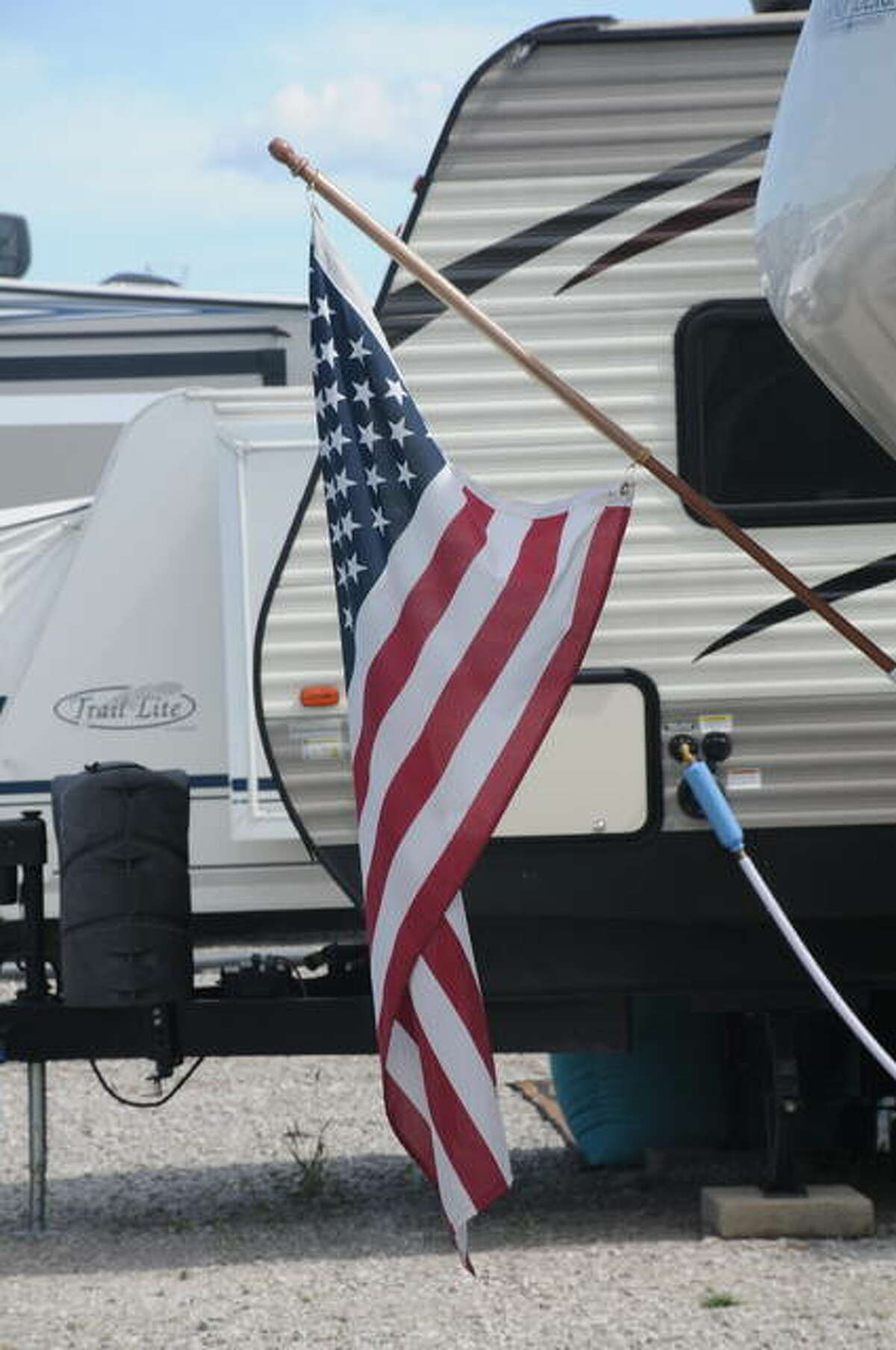 A number of flags could be found amid the RVs Sunday at 5 Diamond Campground in Hartford.