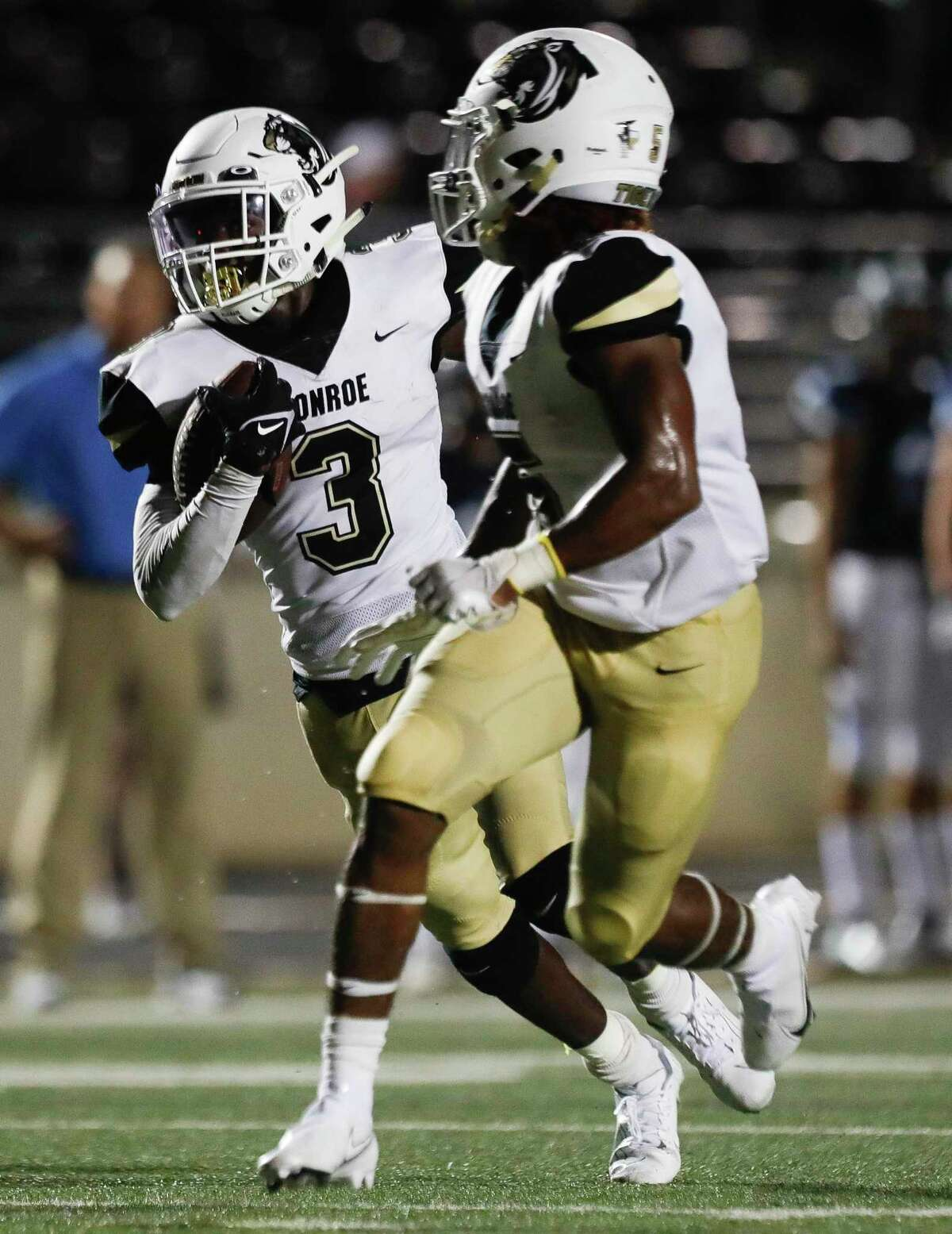 Conroe wide receiver Louis Williams III (3) runs for a 47-yard touchdown during the third quarter of a non-district high school football game at Turner Stadium, Thursday, Sept. 2, 2021, in Humble.