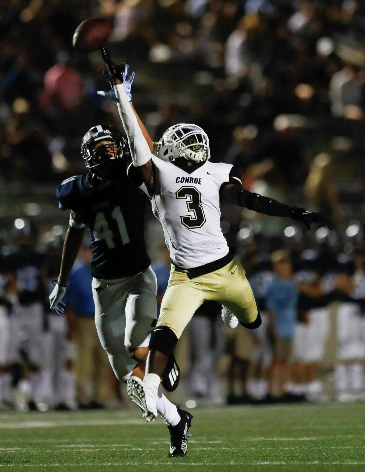 Conroe wide receiver Louis Williams III (3) tries to haul in a apss during the third quarter of a non-district high school football game at Turner Stadium, Thursday, Sept. 2, 2021, in Humble.