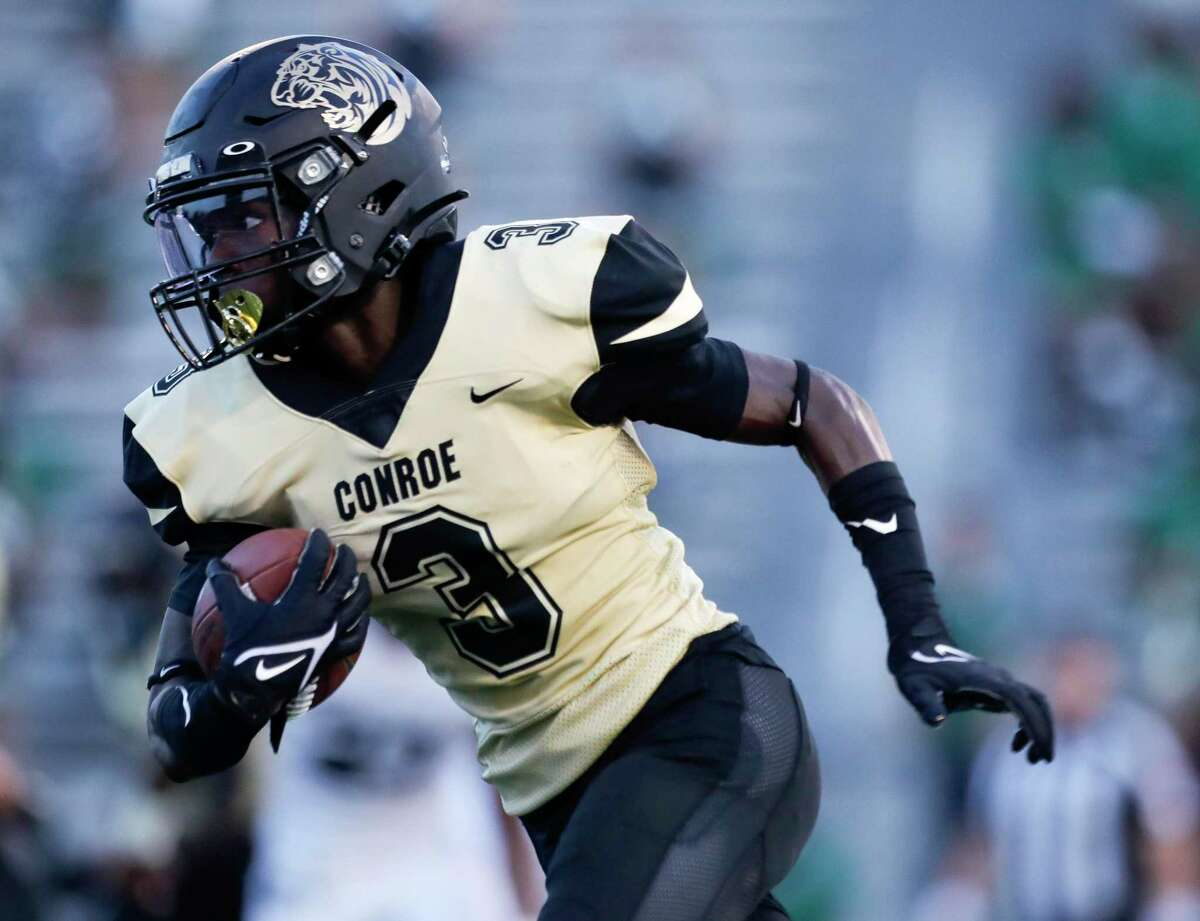 Conroe receiver Louis Williams III (3) runs the ball during the first quarter of a non-district high school football game at Buddy Moorhead Stadium, Friday, Aug. 27, 2021, in Conroe.