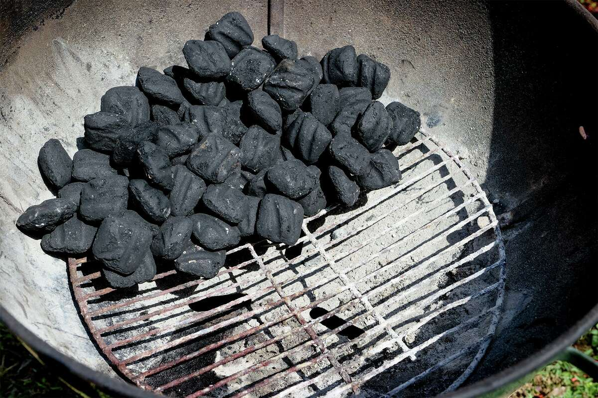 An indirect configuration of charcoal in a grill, with the charcoal all on one side, creates hot and cool zones in the grill.