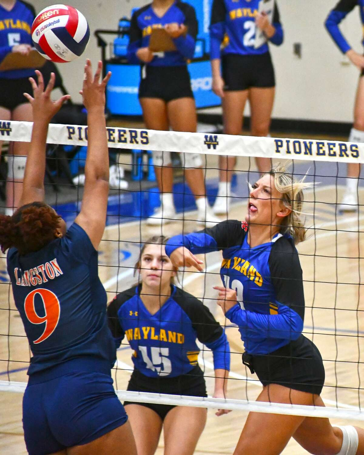 Wayland Baptist's Amber Daniel hits the ball over Langston defender Allanah Drayton-Campbell during a Sooner Athletic Conference volleyball game on Saturday morning in the Hutcherson Center.