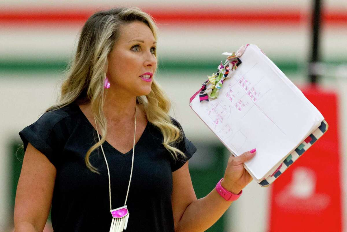 College Park head coach Candice Collins Gibson is seen during the third set of a District 15-6A high school volleyball match at The Woodlands High School, Tuesday, Sept. 3, 2019, in The Woodlands.