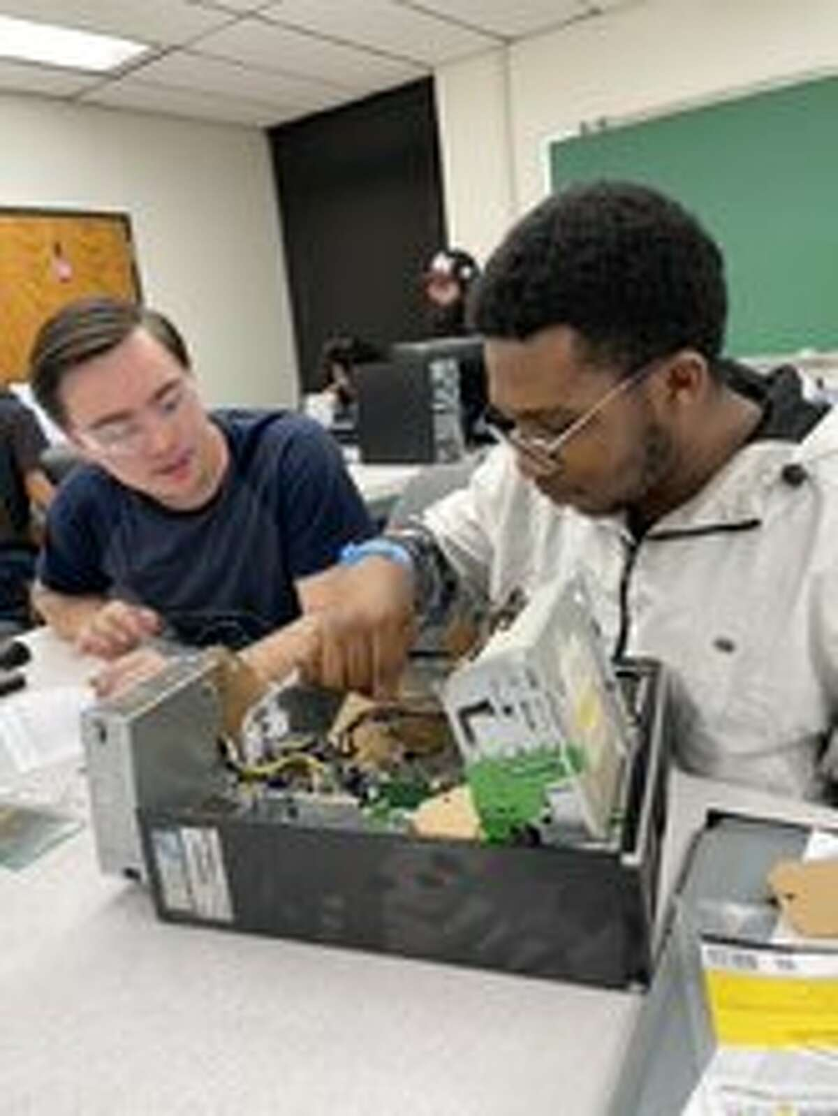Dabrien Ramirez, left, and Cletus (Clay) Maduabuchuku were among the students in MC's PC Hardware class that utilized a $10,000 donation of computers from Mark Knox Flowers.