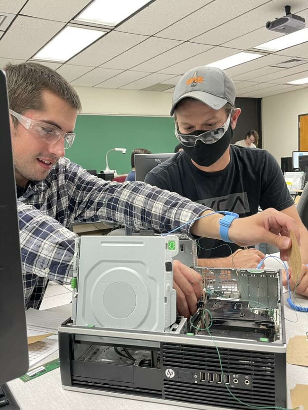 Kegan Graves, left, and James Eggleston were among the students in MC's PC Hardware class that utilized a $10,000 donation of computers from Mark Knox Flowers.