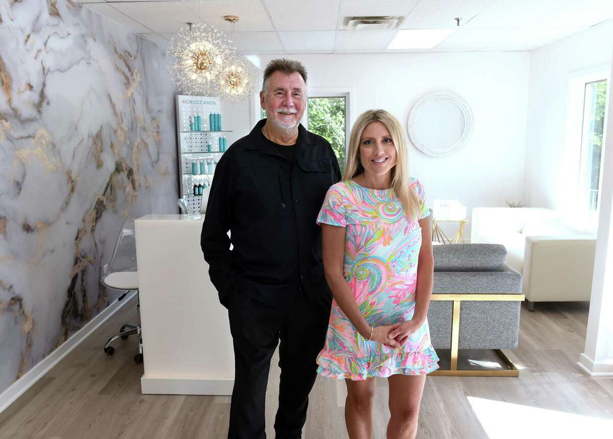Christopher Rollins (left), owner of Christopher's Salon, is transferring the ownership of his salon to Carissa Tropiano, with the new salon moving downstairs and changing it's name to Carrisa & Co. Salon at 1575 Boston Post Road in Guilford where the two are photographed on Sept. 3, 2021.